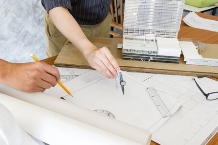 engineer meeting and discuss for architectural project plan on table in office Stok Fotoğraf