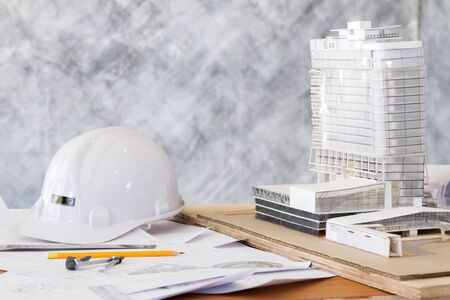 architecture workplace with building model and supplies Stok Fotoğraf