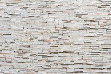 biała nowoczesna kamienna tekstura powierzchni ściany z cegły na tle