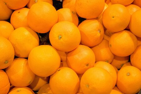 pile of fresh navel orange background - close up view