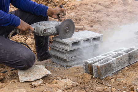 stone cutter: Cutting bricks in construction sites by using the tool specialists.