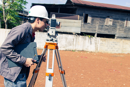 exact position: Engineers survey line columns for the construction of buildings.