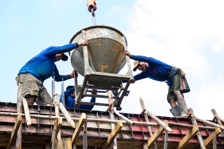 cement pole: NAKHONRATCHASIMA, THAILAND - DECEMBER 24, 2015: Construction concrete floor beams using a crane. Khonburi NAKHONRATCHASIMA THAILAND.