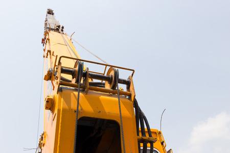 crane bucket: Behind Crane on steel ropes in site construction