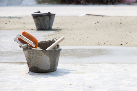 Tools used in plaster or masonry construction sites Stock Photo