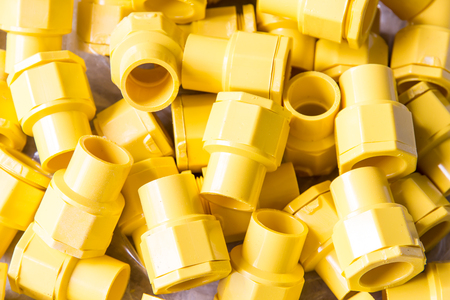 plastic conduit: Fitting protect electrical connections in construction. Stock Photo