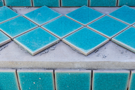 industrial tiler builder swimming pool Reklamní fotografie - 59920755