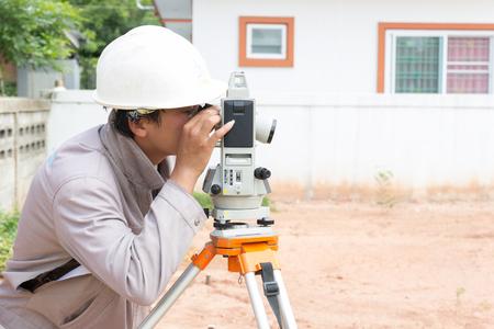 theodolite: NAKHONRATCHASIMA, THAILAND - MAY 3, 2016: Man survey checking before housing construction site NAKHONRATCHASIMA THAILAND.