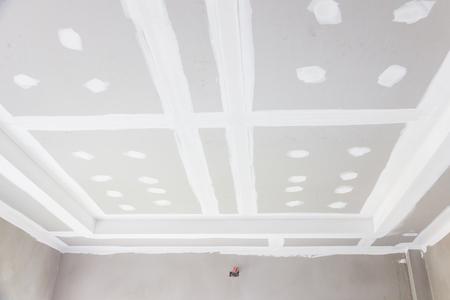 plasterwork: build gypsum board ceiling in construction site