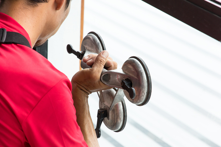 glazier work installing glass in site construction Standard-Bild