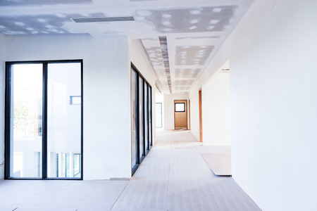 Empty room interior build gypsum board ceiling and Air conditioner in construction site