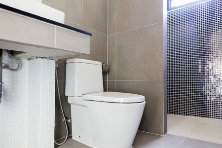 renovated: Modern design home bathroom toilet and sink White colur sanitary ware in the bathroom