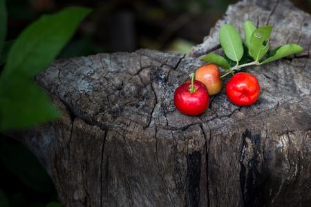 closeup red cherry on wood, thai cherry