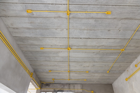 warehouse building: construction industry ,Electric pipe PVC and box under the ceiling in the home building
