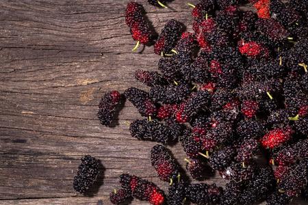 fruit black mulberry on wood background Stock Photo
