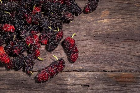 fruit black mulberry on wood background Stok Fotoğraf