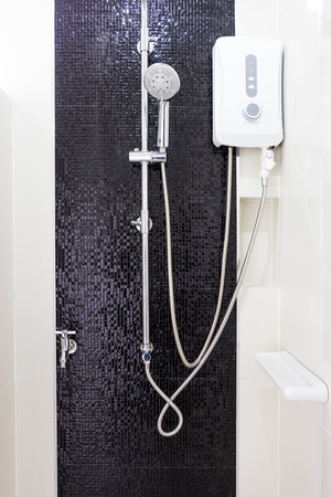 Modern design home Water heater and showwer sanitary ware in the bathroom Stok Fotoğraf - 86258360