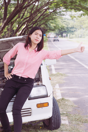 sexy asian woman: Woman with broken car on the road waiting for help.