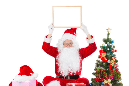 Merry christmas,Santa Claus pointing in white blank sign,Isolated on white background. Stock Photo