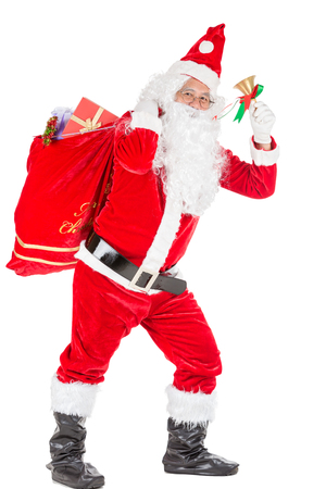 Happy merry Christmas Santa Claus pointing holding Gift Box with Isolated on white background. Stock Photo