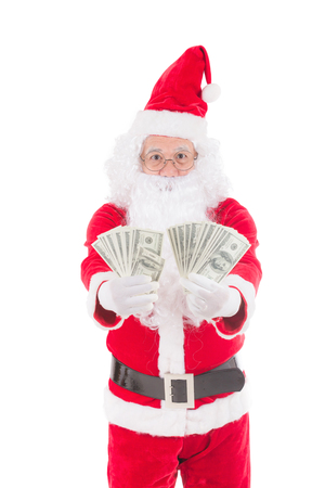 Happy merry Christmas Santa Claus pointing holding Gift money with Isolated on white background. Stock Photo