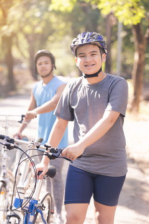 young man riding bicycle in the park ,man lifestyle concept sport Stock Photo