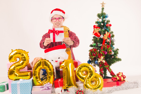 Young men show gift very happy christmas and happy new year 2018