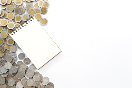 Business finance concept notebook paper on coins background
