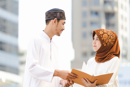 Muslim couple young girl and boy reading book with shopping in the city,Concept education and shopping