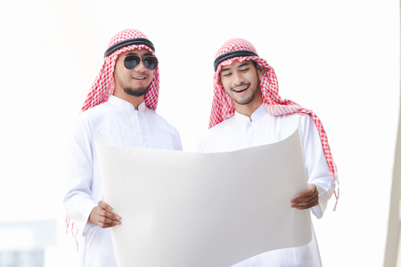 Arab business man looking working on plan peper in the city Stock Photo