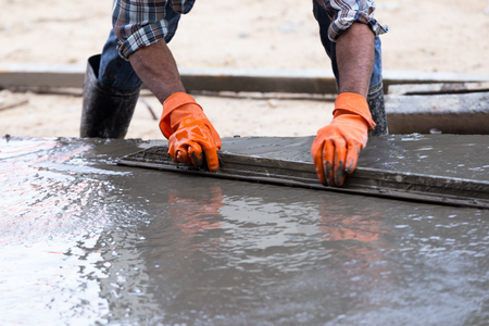 Industry construction men workers with tool concrete mix on road construction Banque d'images