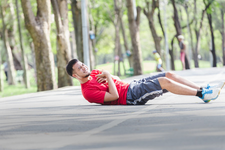 Asian cardiac arrest running young man heart attack in park.Severe heartache Reklamní fotografie - 94116154