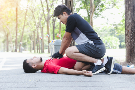 CPR with people with a heart attack in park Stock Photo