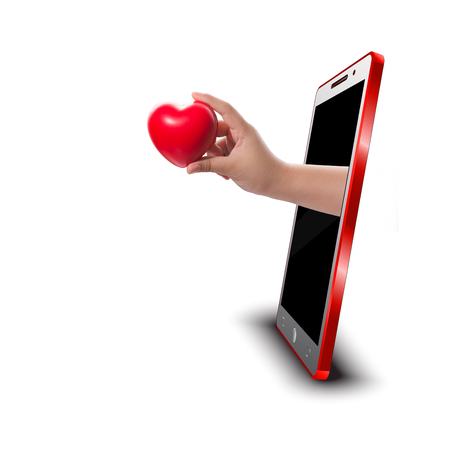 Hand holding RED heart rubber out of screen smartphone 3D,Love concept