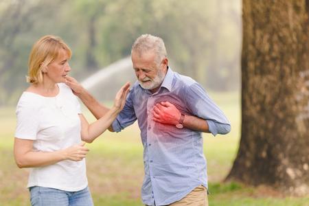 Senior men cardiac arrest heart attack in park.Severe heartache