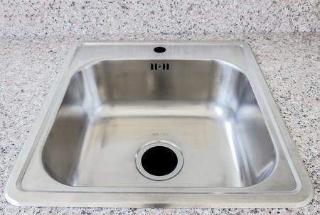 Modern home interior kitchen sink on whetstone 版權商用圖片