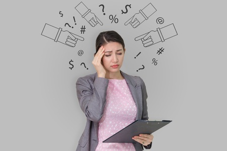 Young business woman stressed isolated on gray wall background Reklamní fotografie