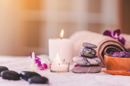 Spa composition setting with candle in room, spa products concept