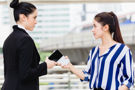Two women fight. Angry business problems at work concept