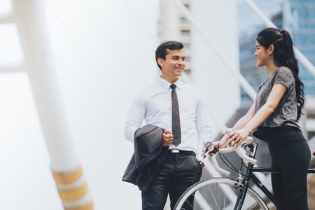 Lifestyle business man and sport woman talking in city background,Health riding bike Zdjęcie Seryjne
