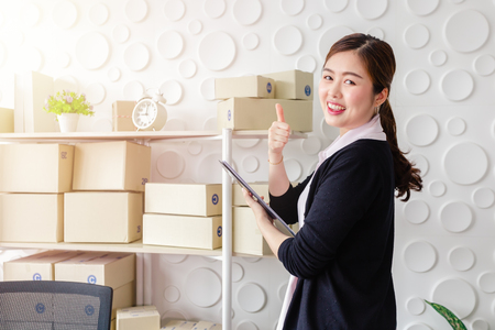 Portrait Asian young women standing smile in home office,Start up small business SME 版權商用圖片