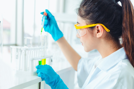 Closeup Science women students working with chemicals in lab Stock Photo