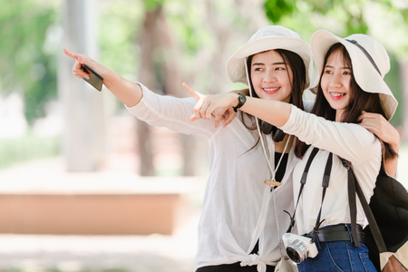 Asian young girls and friends Traveler in city Stok Fotoğraf
