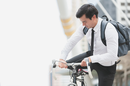 Business man worker riding bicycles in city,Concept ecology bike go to worker Imagens