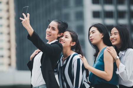 Asian lifestyle businesswoman best friends smiling and having fun walking selfie at the city Reklamní fotografie