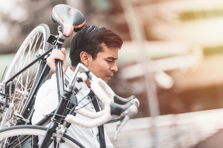Business man worker carrying bicycle in city,Concept ecology bike go to worker