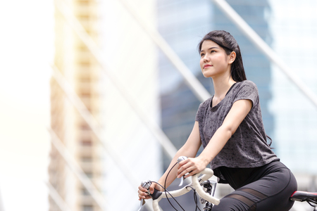 Lifestyle sport woman and health riding bike in city background Archivio Fotografico - 122269728