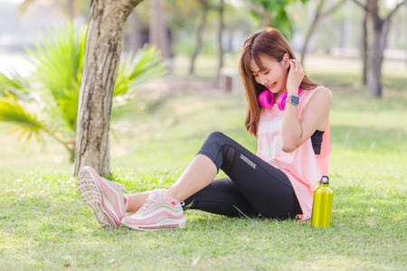 Asian beautiful young woman relaxing excercise in park
