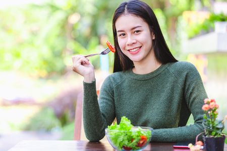 Asian beautiful young girl eating salad vegetable outdoor , Concept healthy body Reklamní fotografie - 122269765