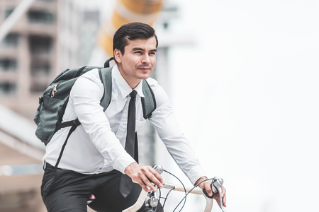 Business man worker riding bicycles in city,Concept ecology bike go to worker Stockfoto
